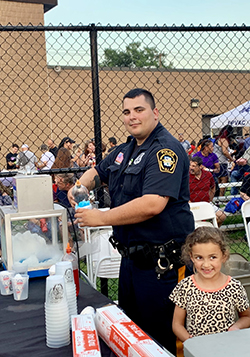 Elmwood Park police officer assisting in the community